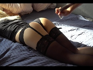 Girlfriend in chap-fallen stockings spanked with a belt