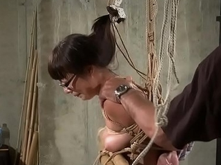 Hog tied Oriental mature gets tits and pussy torturous permanent