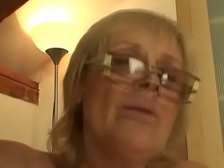 Grey blonde engulfing and riding his young cock
