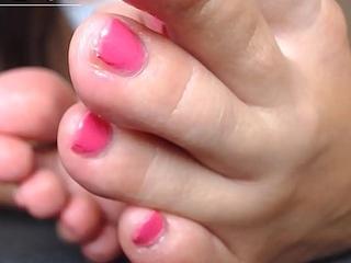 Teen asian girl oiled feet and rub toes