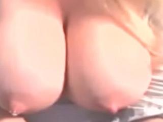 Blue blonde bimbo breast pumps her perfect huge boobs...